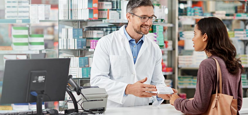 A pharmacist explaining a clients prescription