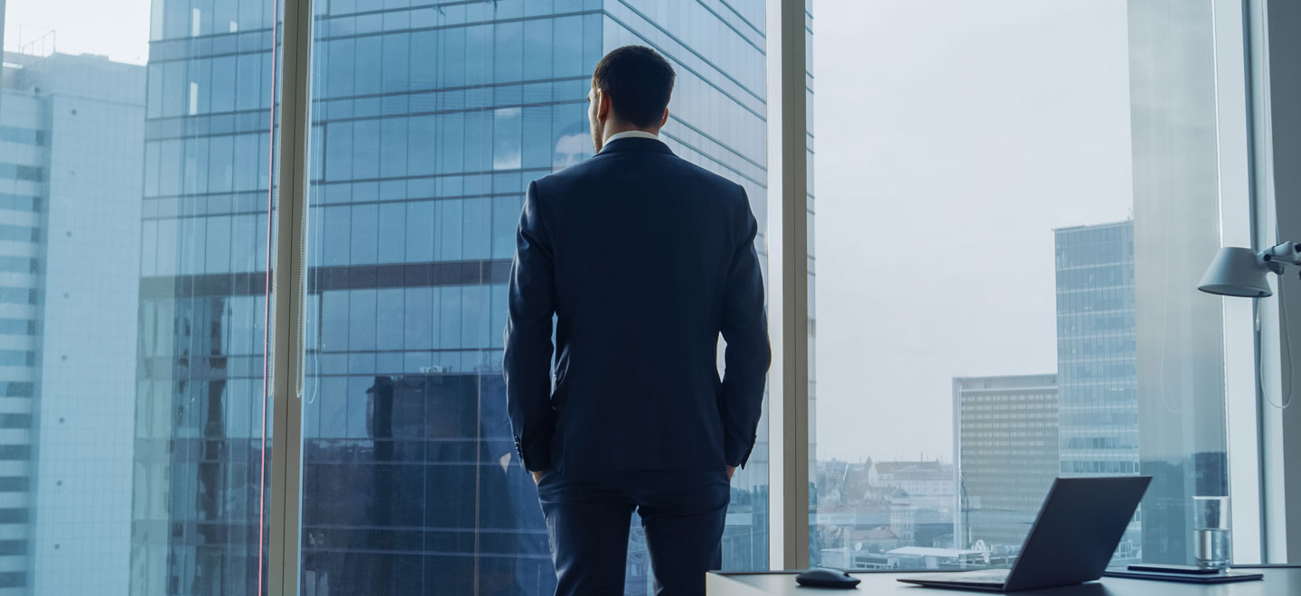 A businessman overlooking the city in his office